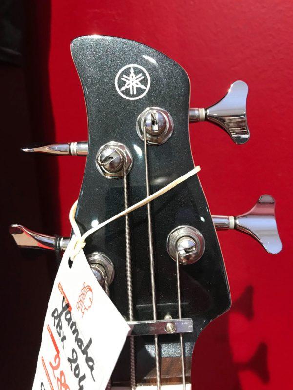 tête de guitare basse noire