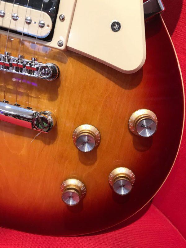 boutons dorés guitare orange