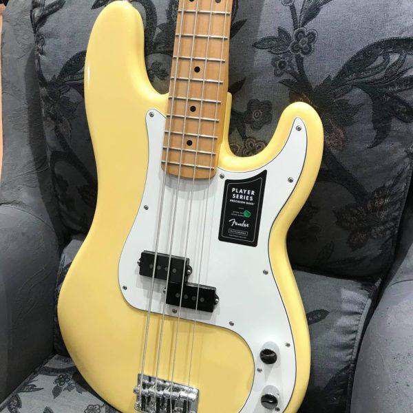 guitare basse jaune et blanche